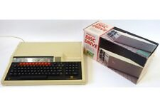 BBC Master with dual disc drive, discs and manuals etc