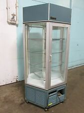 """Traulsen"" Commercial 6 Sided Lighted Refrigerated Rotating Bakery Display Case"