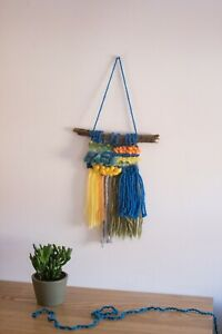 Colourful handwoven wall hanging.Boho weaving interior decoration