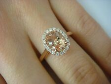 1.10 CT PEACH MORGANITE AND 0.20 CT T.W. HALO DIAMONDS LADIES RING 14K ROSE GOLD