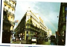 POSTCARD OF A BUSY STREET IN PARIS WITH A RAINBOW OVER THE APPARTMENT