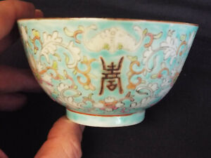 Antique Chinese porcelain tea bowl with blue four character makers mark.