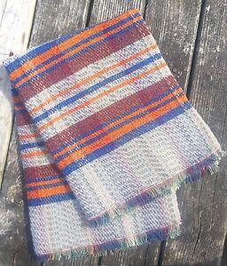 Grey and orange wool blanket british made by tweedmill