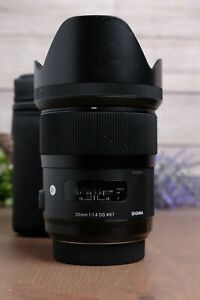 Sigma 35mm f/1.4 DG HSM Art Lens for Sony A-Mount with Hood, Caps and Bag