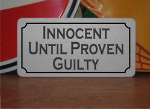 Innocent Until Proven Guilty Metal Sign
