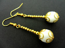 A PAIR OF DANGLY WHITE JADE  BEAD GOLD PLATED DROP EARRINGS.