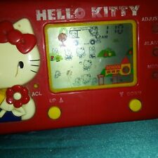 80s TOMY HELLO KITTY SCHOOL BUS HANDHELD GAME; No box or instructions