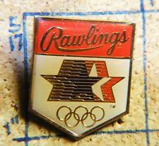 "RAWLINGS SPORTING GOODS OLYMPIC STARS IN MOTION GOLDTONE METAL 1"" LAPEL PIN"