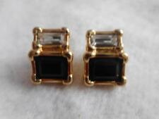 Signed Swarovski black & white crystal pierced stud earrings.