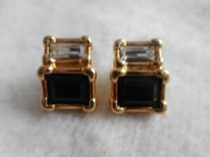 Signed Swarovski black & white crystal pierced stud earrings.