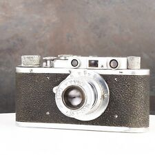 ^ Soviet FED-1 Rangefinder Camera w/ Copy Elmar 50mm f3,5 Leica Knockoff