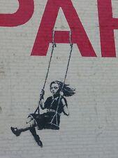 Banksy -Niña en colump. Ed. 300 uds Firma impresa. Num. a lapiz. Certif. Edicion