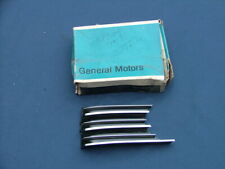 1963 Cadillac grille extension, LH, NOS! trim moulding 1479735