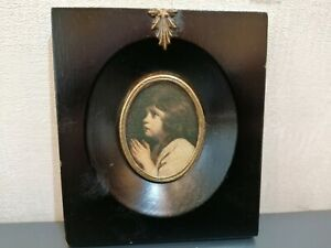 MINIATURE  OVAL PORTRAIT  OF  A YOUNG  CHILD  IN  PERIOD  FRAME.