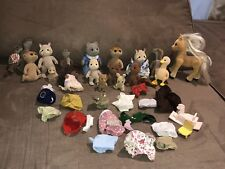 A Sylvanian Families Assorted Figures Bundle with Clothes & Extras