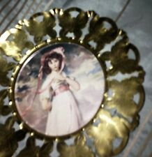 picture of Pinkie, under glass in brass butterfly frame (made in England)