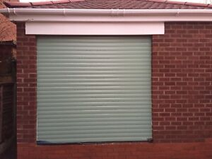 Chartwell green Fully installed electric roller Garage Door Insulated fitted