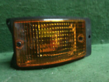 1983 - 1985 Porsche 944 bumper mounted park light amber  By Hella  Used