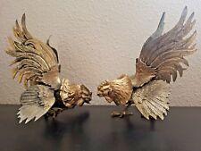 Paire de coqs de combat en métal argenté