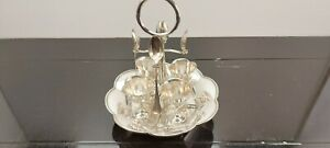 An Antique Silver Plated 4 Egg Cup Set With Stand And Spoons.very collectable.