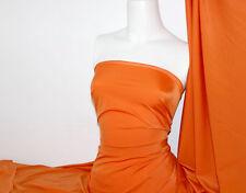 Orange Lycra/Spandex 4 way stretch Finish Fabric