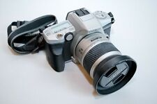 Minolta Maxxum 4 with carry strap and zoom lens