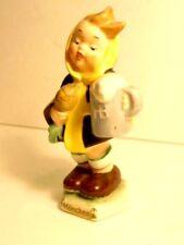 """older Goebel figurine of girl with stein """"Munchen"""" on base; full Bee in V mark"""