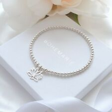 Sterling silver lotus flower charm bracelet, dainty beaded stacking jewellery
