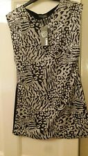 Dress short Size L but probably a 10 or a 12. Stretch