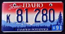 "IDAHO "" FAMOUS POTATOES SCENIC MOUNTAINS "" 1995 ID Vintage Graphic License Plate"