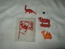 A Small lot R & L Cereal Toy Dinosaur & Snap Kit Camel Train pieces for parts