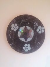 Black and pale blue  vinyl quartz clock. Flowers and star. Handmade. Modern.