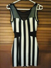 Woman's black & white striped V neck contoured dress with mesh cut outs size 8