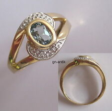 121 - Dekorativer Ring aus Gold 585 mit blauem Topas -305-