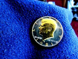 J.F KENNEDY 24K GOLD PLATED HALF DOLLAR  LAYERED WITH THICK CLEAR POLYRESIN