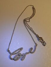 Swarovski® signed Swan crystal pave gold plated Love Affair Necklace Pendant