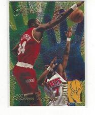 1994-95 FLAIR BASKETBALL REJECTORS INSERT HAKEEM OLAJUWON #4 OF 6 ROCKETS