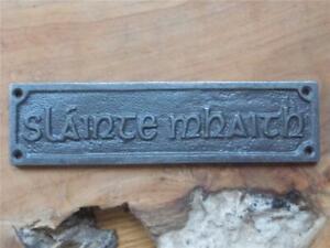 VINTAGE STYLE CAST IRON WALL PLAQUE GAELIC SLAINTE MHAITH GOOD HEALTH PUB SIGN