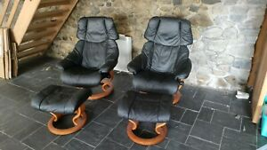 Pair Of Ekornes Stressles Reclining Leather Swivel Chairs