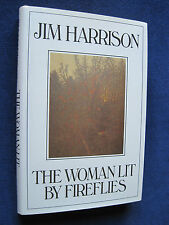 THE WOMAN LIT BY FIREFLIES by JIM HARRISON - First Edition in Dust Jacket