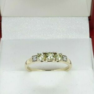 9ct Gold 0.33ct Demantoid Garnet Trilogy and 0.03ct Diamond Ring