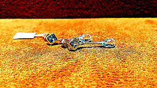 14k Yellow Gold Earring with Tear Drop Shape Blue Topaz.