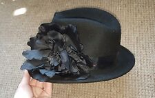 ladies ted baker hat with black flower fascinator style decoration