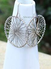 Beautiful Sun silver tone wire wrapped round earrings on elegant silver hooks