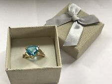 TRILLION 5.0CT BLUE TOPAZ RING SIZE 7 IN 10KT YELLOW GOLD/SMALL DIAMONDS