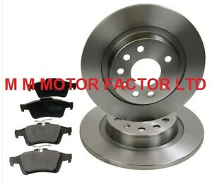 TWO REAR SOLID BRAKE DISCS AND A SET OF FOUR BRAKE PADS LH AND RH SAAB 9-3  02-