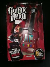 NEW Guitar Hero Pocket-Sized Electronic Game Red 10 Tracks Basic Fun Inc.