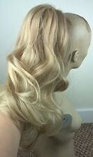 medium blonde wavy curly claw clip in long pony tail hair extension piece
