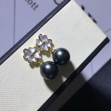 elegant pair of 10-11 mm tahitian round black pearl earring 18k gold