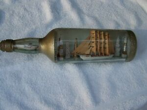 Antique Vintage Ship In A Bottle sailing ship with all sails up and a steamer